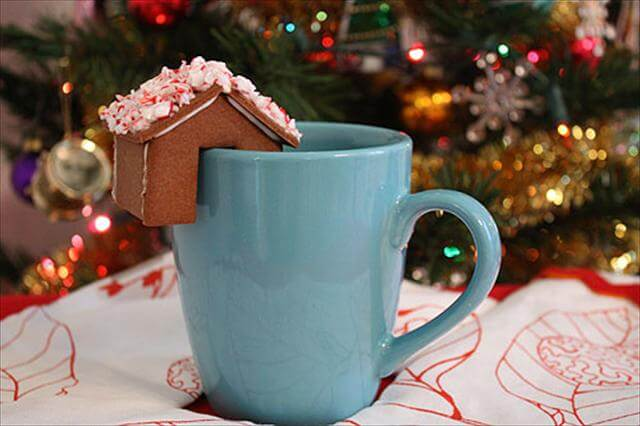 Tiny gingerbread house that perches on the edge of your mug