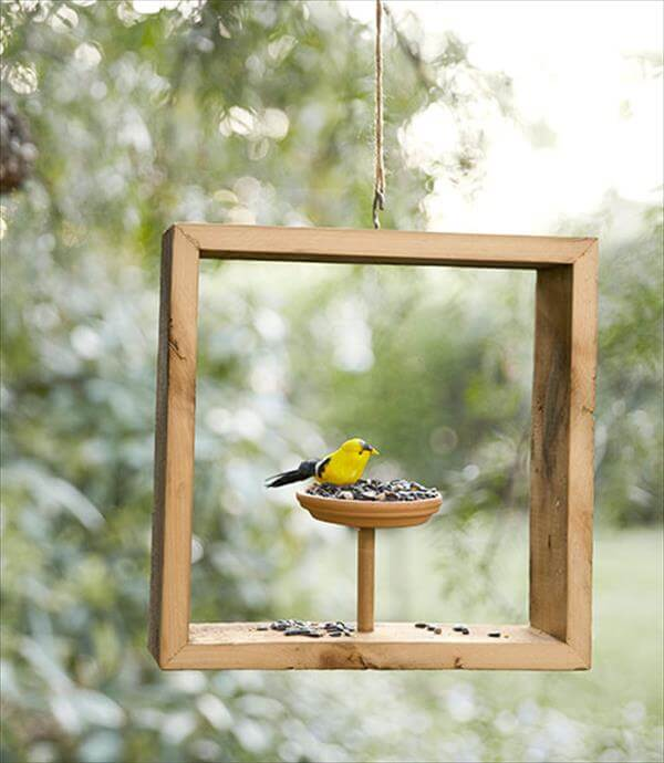 handcrafted wooden bird feeder